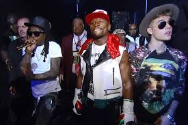 Floyd Mayweather Jnr, coming out the entrance with his TMT cronies, Lil Wayne and Justin Beiber