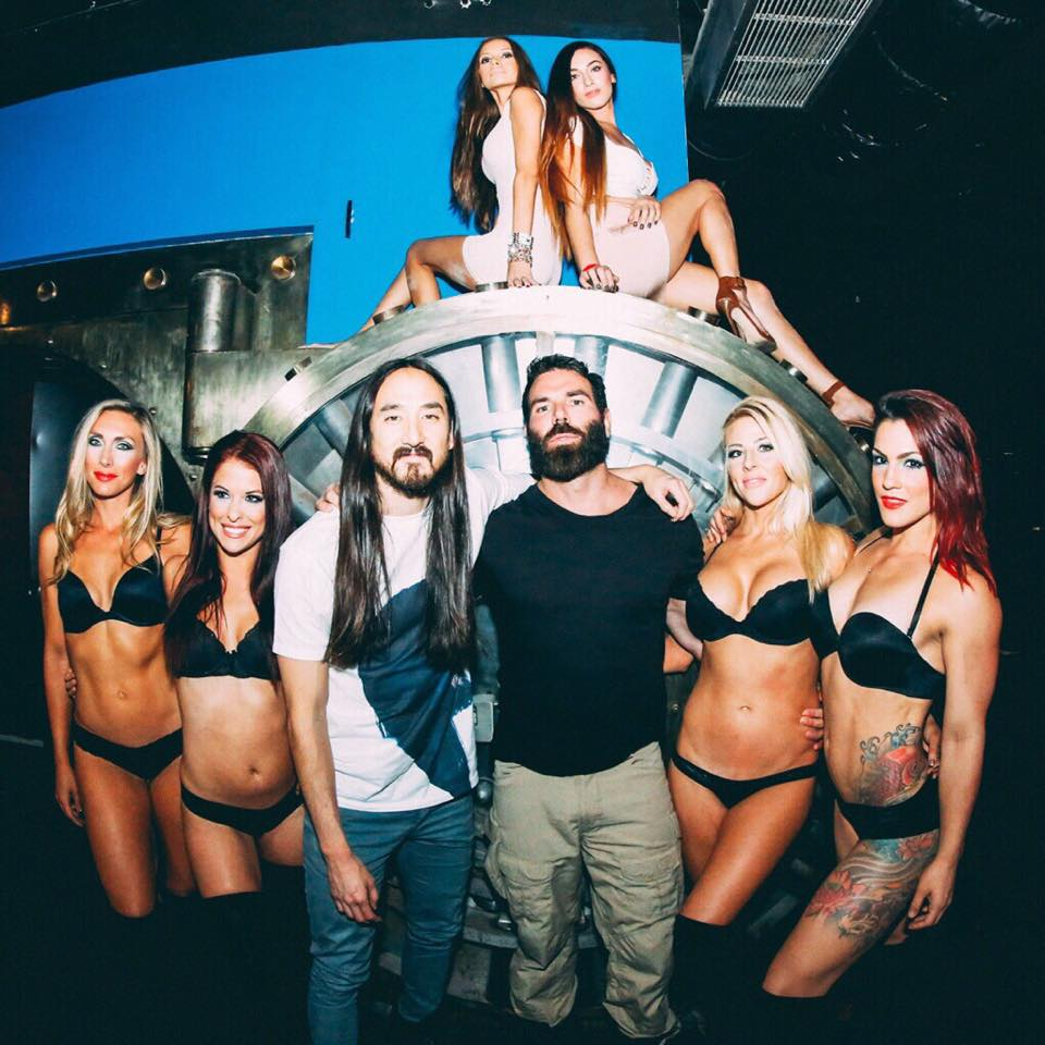 Dan Bilzerian, posing with celebrity friend, Steve Aoki months before the incident last week.