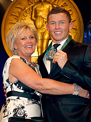 HAPPIER TIMES: Todd Carney celebrates a Dally M win with his long-suffering mother. Well before the NRL decided to make a scapegoat out of him.