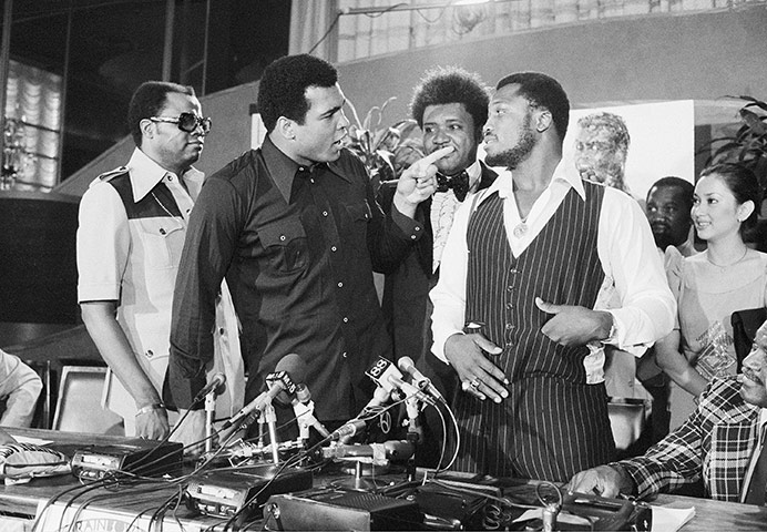 New York City Thursday, July 17, 1975, the original Thrilla in Manila - Joe Frazier and Muhammad Ali poss with Don King at a press conference to promote the fight.