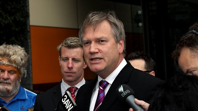 A defeated and disheveled Andrew Bolt leaves the Supreme Court in Melbourne after being found guilty of Racial Vilification