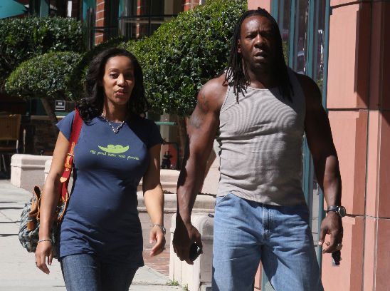 Booker T and his wife, Sharnelle, leaving the police station on Wednesday