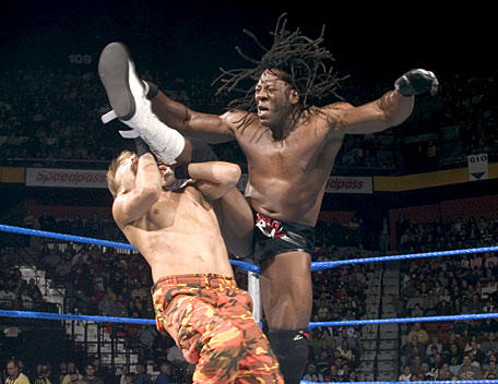 "Booker T ""Scissorkicks"" a competitor in the ring"