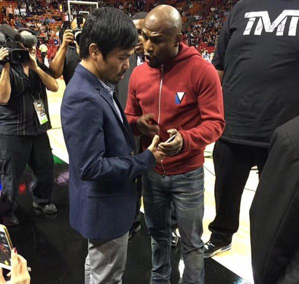 Pacman and Money Maweather meet for the first time at a Miami Heat in game on Tuesday night.