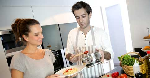 "Tom and Emily preparing a ""hearty"" vegan meal at home. PHOTO: Daily Liberal/AAP"