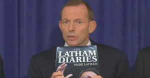 Tony Abbott shows off Mark Latham's political diary at the National Press Club. PHOTO: ABCNews24