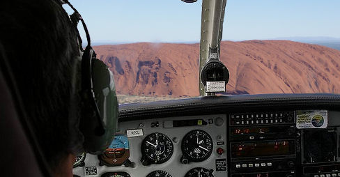 NT Pilot arrested after alleged touch and go incident on Uluru