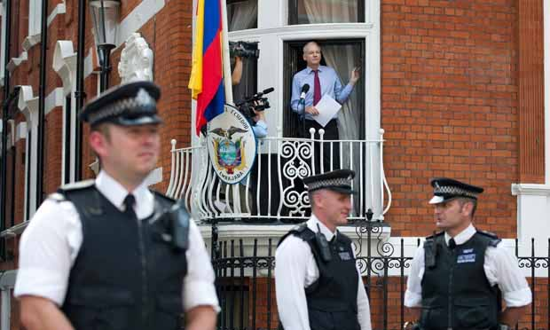 Assange addresses his enemies and supporters from the safety of a balcony at the Ecuadorian embassy in London