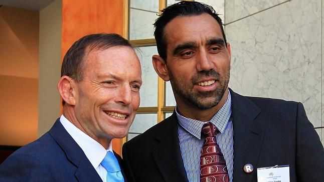 Tony Abbott poses with 2014 Australian of the year, Adam Goodes.