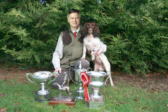 """It's a passion of mine"" Bolt pictured with his award-winning spaniel bitch, Peta. SOURCE: Fairfax Media."