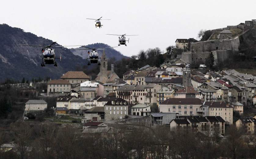 Helicopters of the French gendarmerie and emergency services fly over Seyne-les-Alpes as