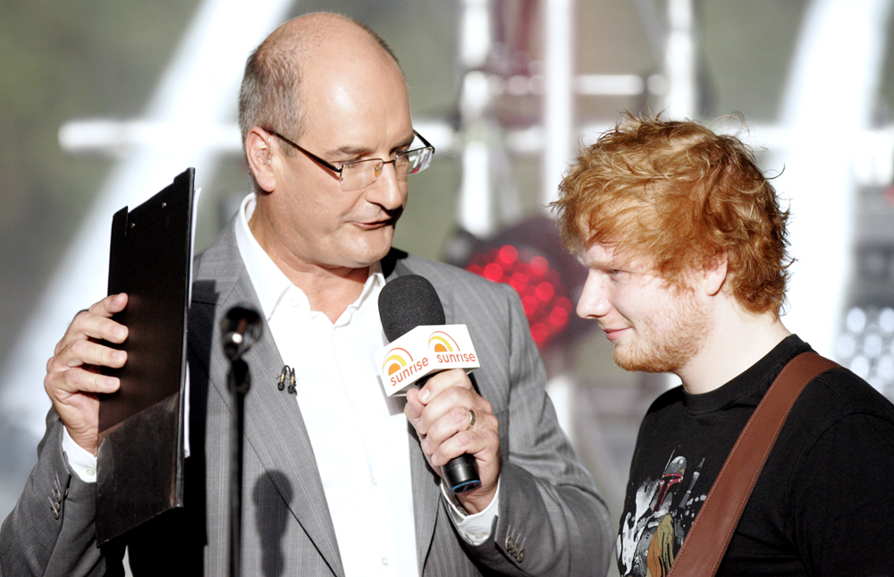 David Koch is made to look unusually handsome when paired next to the extremely pasty rednut known as Ed Sheeran