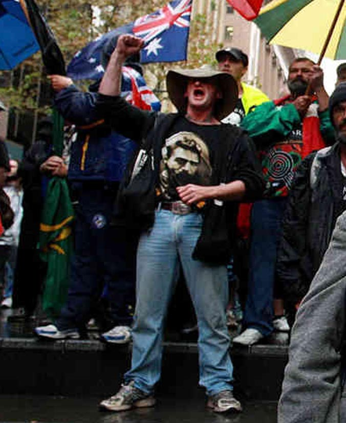 """Peaceful and classy"" protestors gather in the rain at Martin Place on Saturday in Sydney to protest the alleged 'Isalmisation' of Australia."