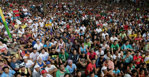 Thousands sit cross-legged in the Philipines to watch a women-basher, bash ones of their own