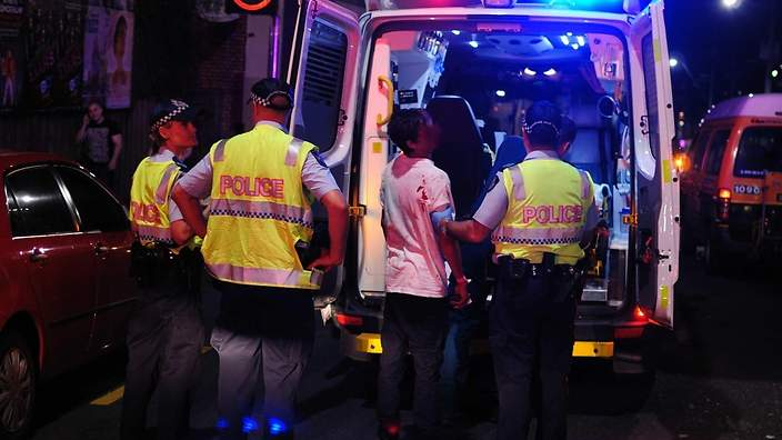 An ambulance arrives at The Waratah Hotel last night, after Ken Cranney was assaulted by hotel regular, Ted.