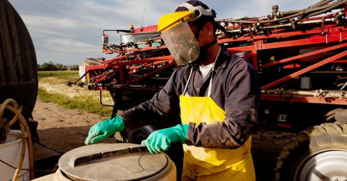 Farm workers are required to wear PPE when handling DHMO in some jurisdictions.  PHOTO: Supplied