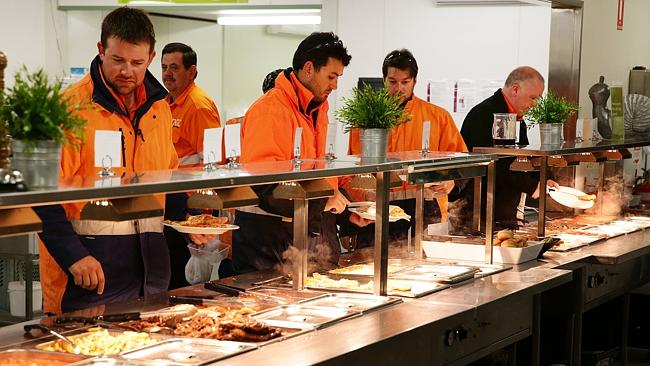 Moranabah miners serving themselves breakfast at bain-marie. Most miners put on an estimated 10-20 extra kilos while eating deep fried food on the job.