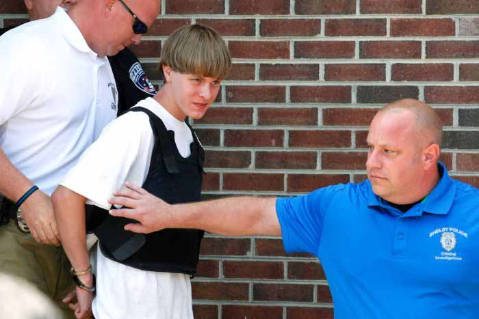 Dylann Roof, 21 is lead into custody in a bulletproof vest. It is quite clear that he does not have much to look forward to in prison.