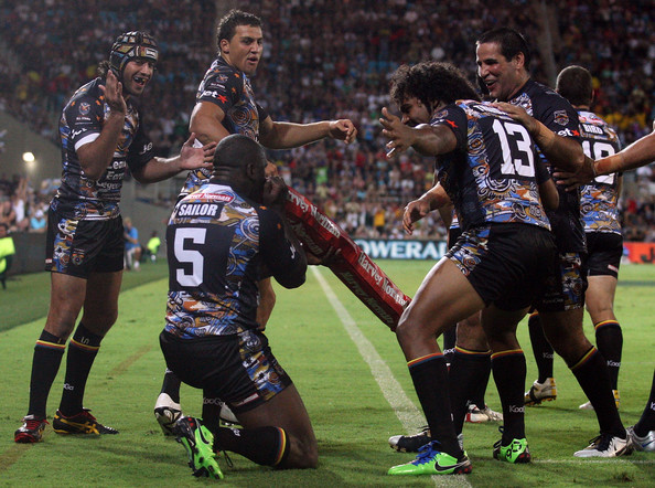 Wendell celebrates his last ever NRL try by playing an imaginary didgeridoo, surrounded by the best players in the NRL