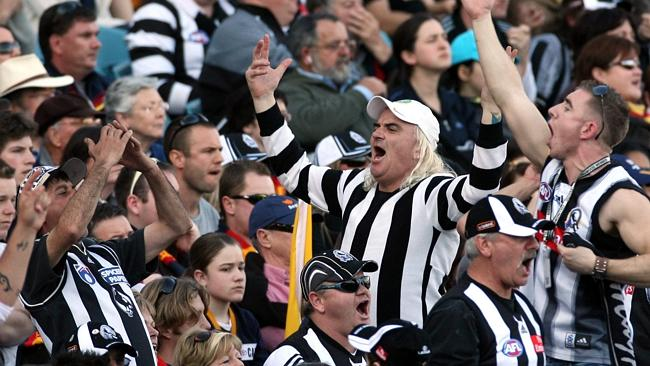 Lenny Lowy riles up the low-breed crowd of Collingwood supporters
