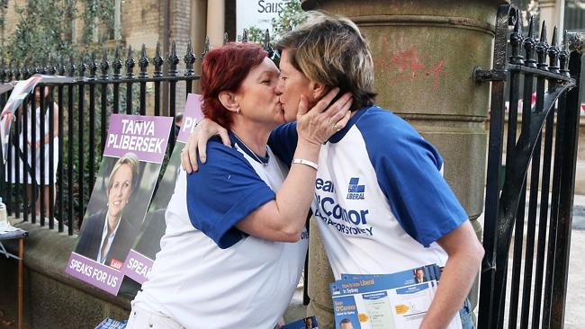 Tony Abbott's incredibly gay sister, Christine Forster kisses her partner Virginia Edwards while handing out Liberal leaflets