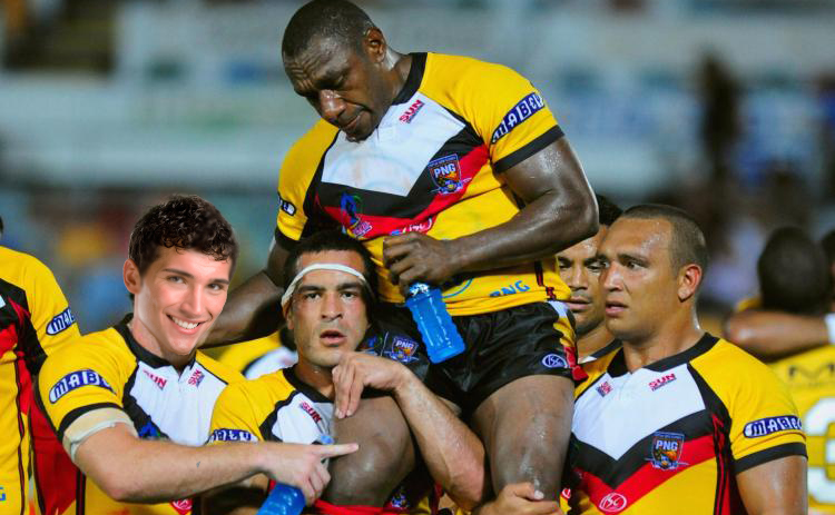 Shiva (far-left) celebrates with his team-mates, the PNG Kumuls