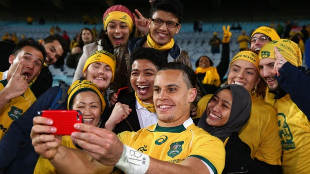 Toomua's fans take the chance to get a selfie with him, despite his haircut