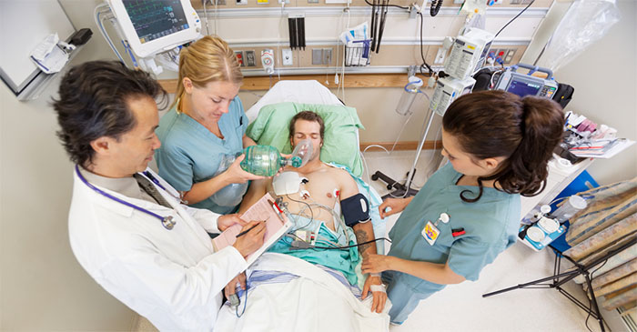 A patient receiving an emergency nang and intravenous butter chicken after consuming an entire 10-pack of MDMA caps and a carton of Jim Beam cans. PHOTO: Supplied.