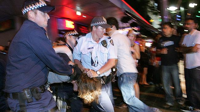 AAP cameras capture a traditional Queensland man in his natural environment, being manhandled by overzealous police represented an ever-increasing nanny state