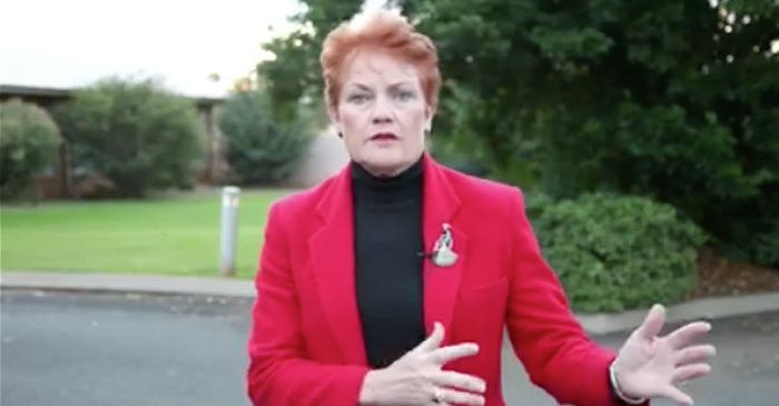Ginger-Headed Woman In Bright Red Blazer Criticises Minorities For Not Blending In