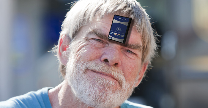 Entrepreneurial tramp has PayPass™ terminal installed on forehead