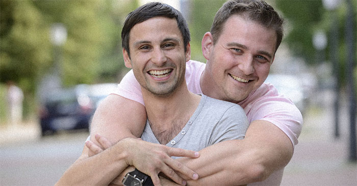 Two mates softly embrace after learning they're tunnel buddies