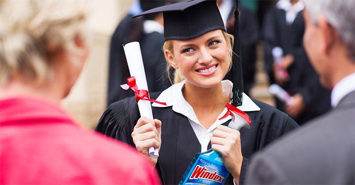 Female law graduate receives Windex to clean the glass ceiling