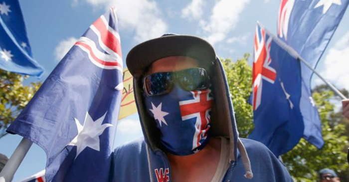 """Ban The Burka"" Says Man Wearing Australian Flag Over His Face"