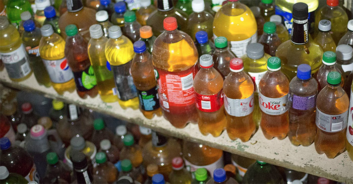 Man accused of taking the piss found to have over 300 bottles of piss in bedroom
