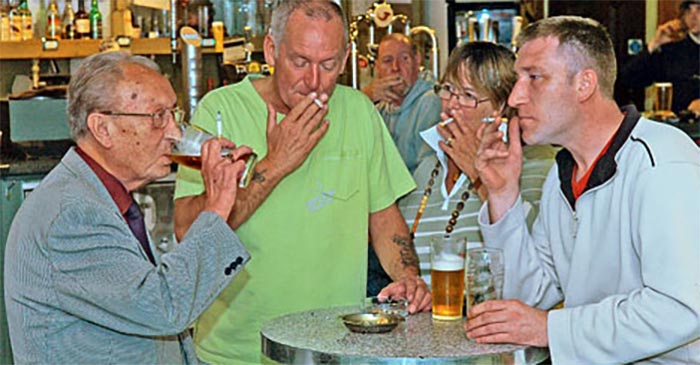 Report: Happiest, healthiest countries still have smoking in pubs