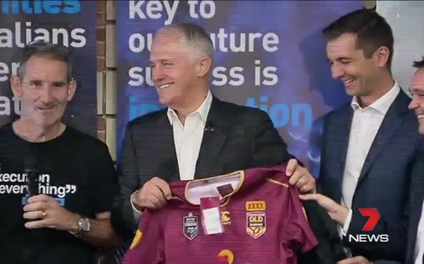Turnbull Poses With Relevant Football Jersey Associated With Upcoming Sporting Fixture