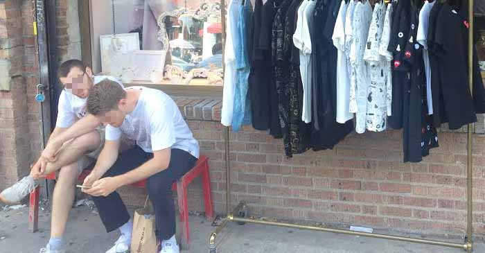 Unattended Boyfriends Bond Over Memes While Placed Outside Female Fashion Outlet