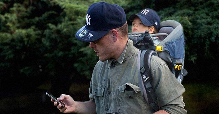 New White Upper-Middle-Class Father Receives Standard Issue Yankees Hat