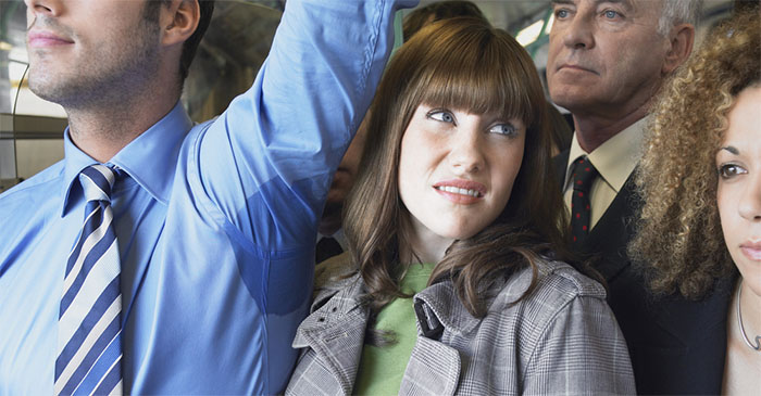 Commuter On Hot Packed Train Wonders If It's All Going To Be Worth It In The End