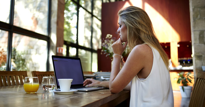 Freelancer Using Free Wifi In Cafe A Little Annoyed They Are Playing Spotify With Ads