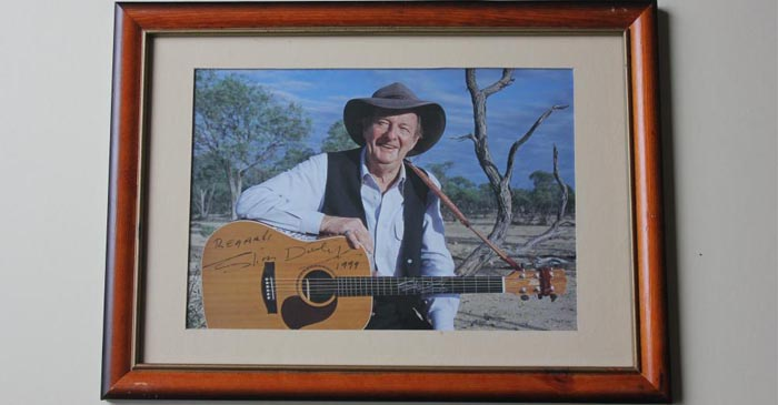 Framed Photo Of Uncle Slim Takes Pride Of Place Above Fridge In Murri Grandma's Kitchen